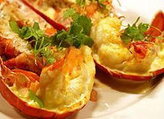 Lobster Thermidor  fresh Cornish Lobster - 1 per person (we can provide both cooked and live) Parmesan cheese (grated) Sauce 30g butter 1 shallot, finely chopped Fish stock White wine 100ml double cream English mustard Chopped parsley Lemon juice Salt & freshly ground black pepper