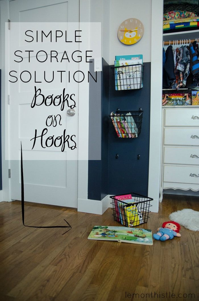 Simple storage solution book baskets on hooks adorable for Hampers for kids rooms
