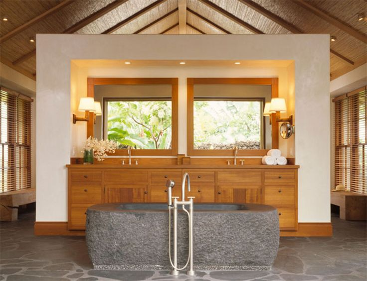 This one looks even more tropical thanks to of the stone bath tub, and the wood used not just for the vanity but even for the ceiling ➤To see more Luxury Bathroom ideas visit us at www.luxurybathrooms.eu #luxurybathrooms #homedecorideas #bathroomideas @BathroomsLuxury