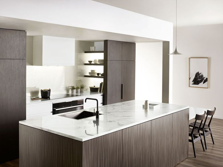 Benchtop is in Diamond Gloss 'Carrara Marble'.