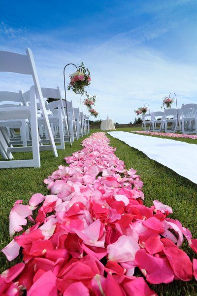 We love this creative ombre rose petal aisle with pink wedding flowers. The wedding was held at The Clubhouse at Peacock Gap Golf Club. Designed by Green Bouquet Floral Design located in San Francisco Bay Area in Marin County #marinweddings  #weddingflowers