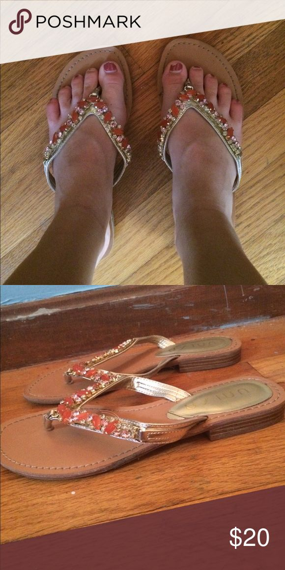 Dressy flip flops Tan flip flop with a small wedge. Coral, light pink and gold gems on the straps. Worn a few times but in great condition Unisa Shoes Sandals