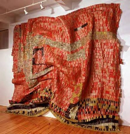 *El Anatsui from Ghana *Made with stiff beer cans that cohesively look unbelievably fluid. Makes me want to wrap it around myself like a dress.