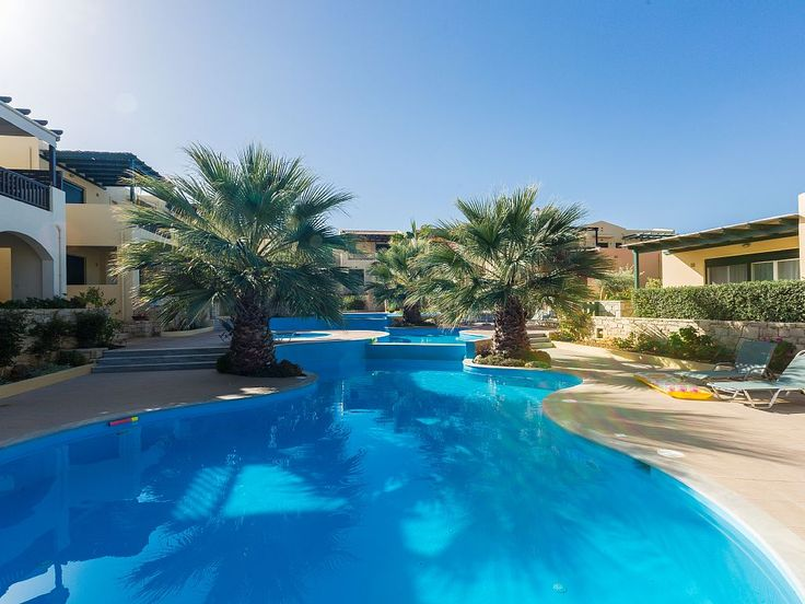 Panormos apartment rental - The complex has a unique-shaped, shared pool!