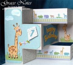 This shutter card features a pair of chubby giraffs and the perfect theme for Baby's 1st birthday.