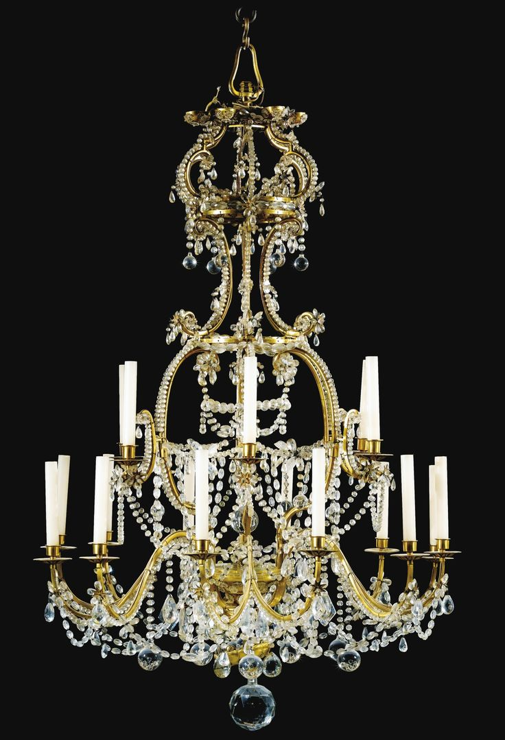 A GILTBRONZE MOUNTED CUT GLASS CHANDELIER IN RÉGENCE STYLE.