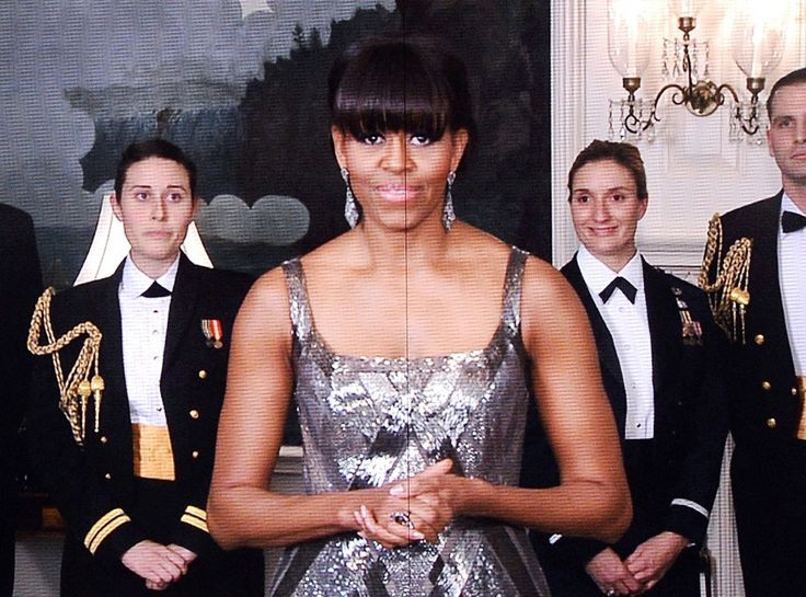 Remote Black Tie from Michelle Obama's Best Looks  FLOTUS appeared via satellite to help present the Best Picture Oscar at the end of the 2013 Academy Awards.
