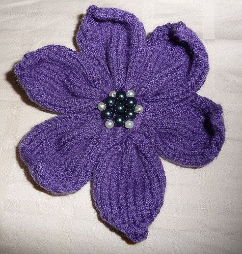 Knitted Flower. You get a lot of very cool patterns out there for flowers, but all crocheted. This pattern is actually knitted and i think if you do it right, you could layer it up as well
