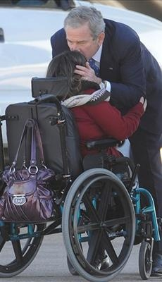 President George W. Bush with a disabled United States Citizen... Have we ever seen Obama have this type of agape love for a stranger?