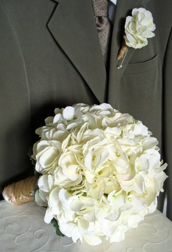 white hydrangea bouquet and boutonniere. I like this ione too. its wrapped in the twine. @Robyn Jones
