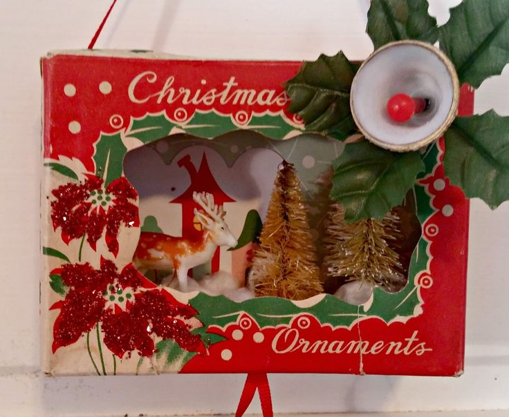 These adorable Christmas dioramas are made with vintage ornament boxes!