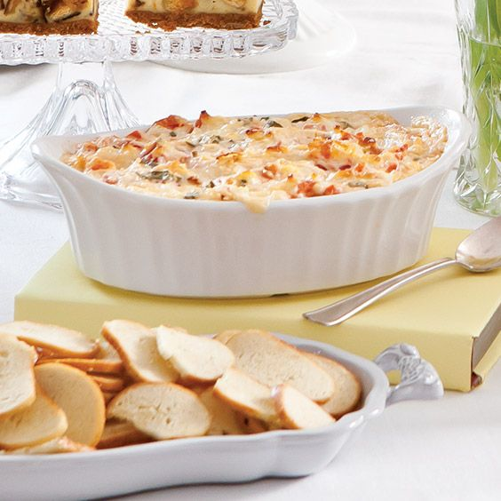 This hot and bubbly, cheesy tomato pie dip is so easy to put together.