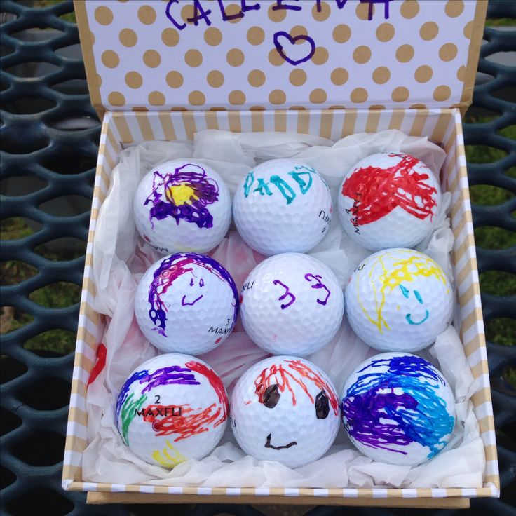 Custom golf balls for dad (or any golfer)... Recycled (let's not get crazy with brand new bc those things are expensive) golf balls from Target by kid with sharpies!!!