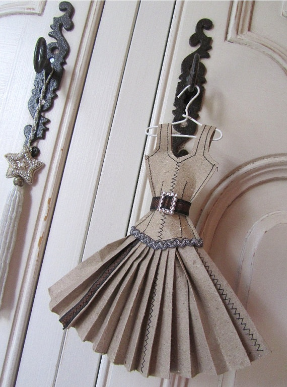 paper dress on a hanger , i think they will look great on the door doing into the hugh walkin closet. bjp