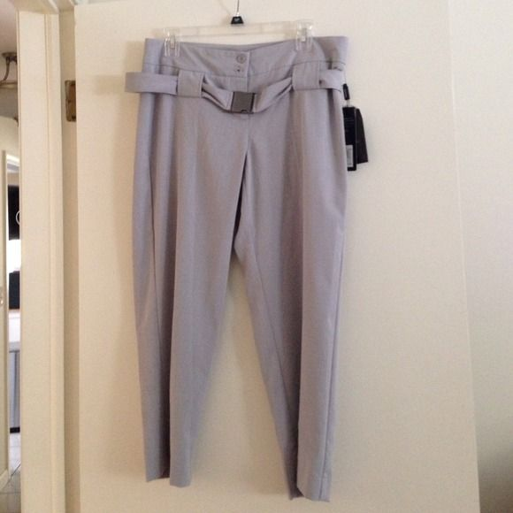 NWT Daisy Fuentes cropped pant - petite length NWT light gray belted cropped pant. Daisy Fuentes petite size 10, about a 22 inch inseam. 58% polyester 36% Rayon 6% Spandex. Daisy Fuentes Pants