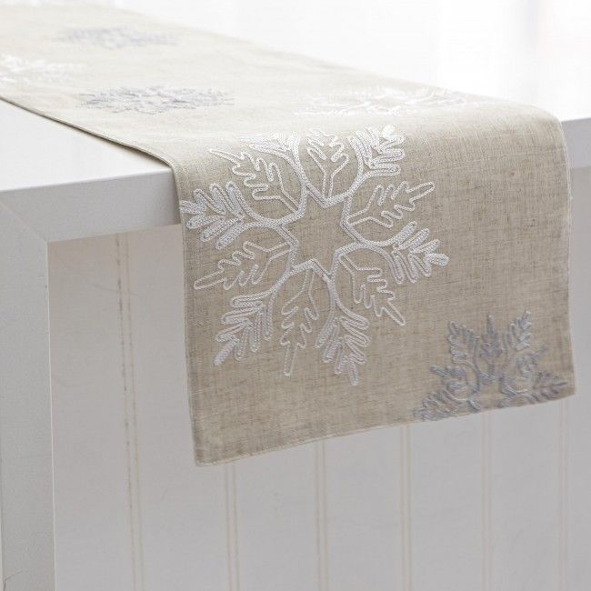 Complete your table masterpiece with a Harman Christmas Snowflake Embroidered Table Runner. Brilliant, unique snowflake patterns accentuate this holiday decor staple, sure to impress family & friends this season.