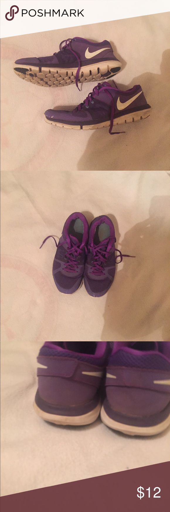 Purple Nike Tennis Shoes Been worn with some signs of wear. See pictures. Very comfortable with lots of wear left in them. Pretty purple color. Nike Shoes Sneakers
