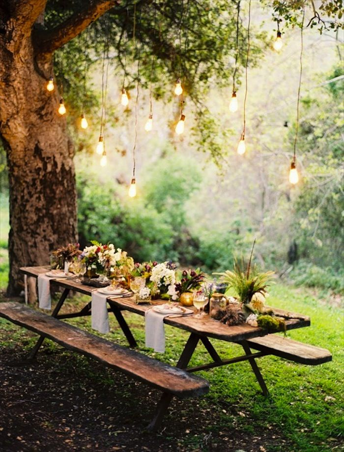 Love the lightbulbs hanging from the trees, love the table set-up