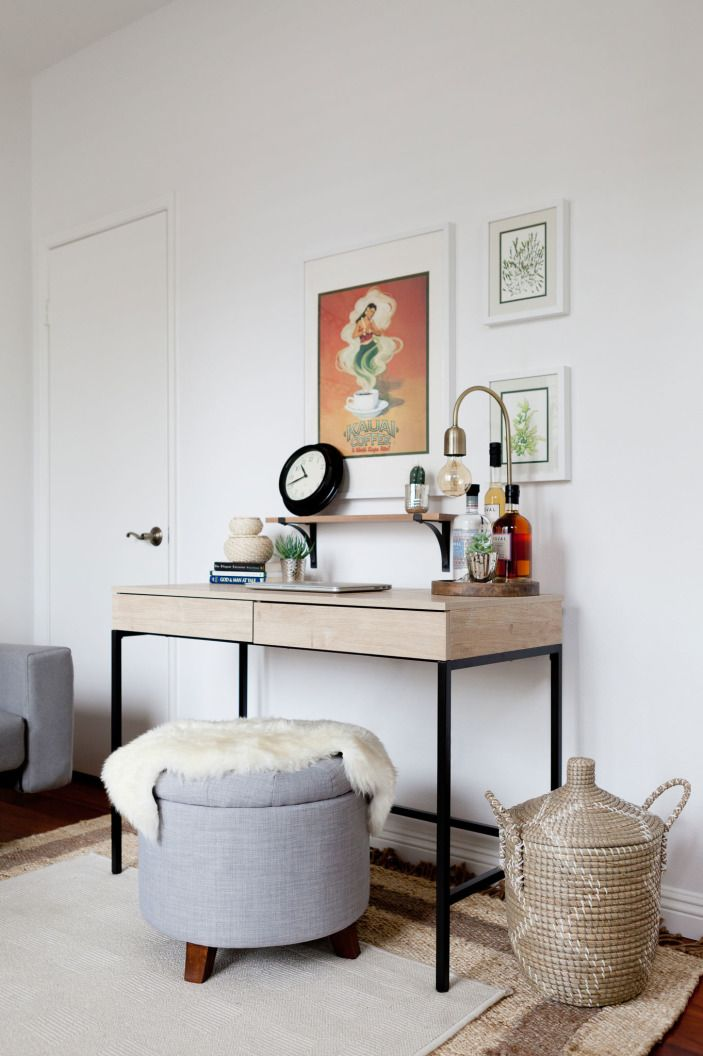 "The neutral <a href=""http://www.target.com/p/darley-mixed-material-desk-threshold/-/A-17314851#prodSlot=_1_22"" target=""_blank"">desk</a> is big enough for Krizia's work, but small enough to stay out of the way of her two kids or any possible guests."