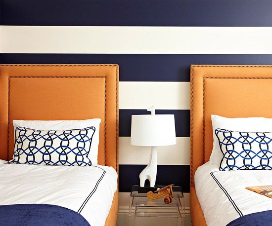 I like the navy and white striped wall. Also like orange as an accent.