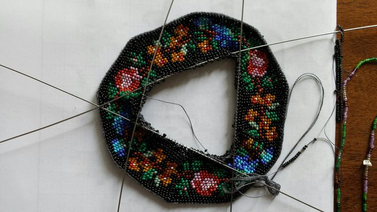 Knitting  a purse with  antique beads on 100 % silk tread.  Made by Tineke Nieuwenhuijse