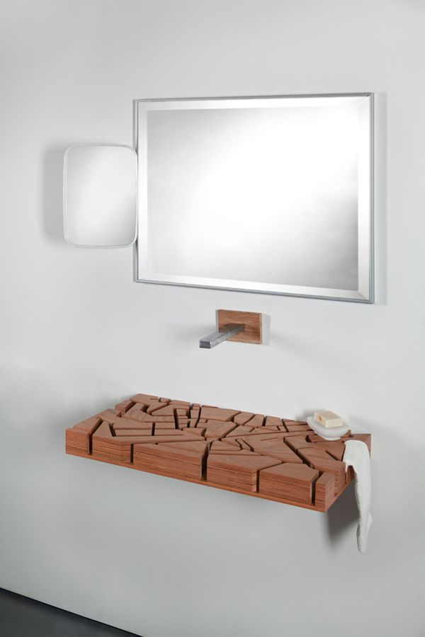Water Map | a flat wood sink modeled after London. Julia Kononenko, a designer from Kharkiv, Ukraine, has taken the flat sink concept in a new direction, creating a laminated wood block featuring a pattern of channels modeled after the streets of central London. When used, the water enters the channels and subtly travels to a drain hidden in the back.