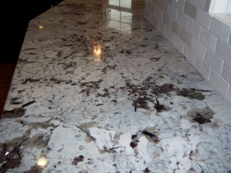 Alaskan White Granite Countertops and Backsplash Ideas - http://www.josephineyatar.com/alaskan-white-granite-countertops-backsplash-ideas/ : #InteriorFurnitures Alaskan white granite – Alaska white-gray granite is dotted background tones ranging from brown to tan, espresso coffee samples in darker shades. There are also pieces of cream woven through this colored marble. This is a neutral style and works well in kitchens style of a variety ranging...