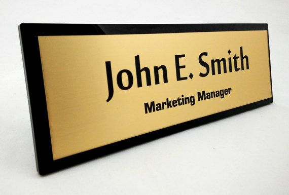 Custom name plaque made of 5mm (0.2 inch) black acrylic and acrylic laminate that imitates brushed brass. A great office gift for your family member, colleague or boss.  Dimensions: 9x3 inches (228x76mm)  Custom orders are welcome.  To complete the order we will ask you to send us a text that you would like to appear on your product. If you would like to change a font etc. dont hesitate to ask but remember that it has to be free for commercial use (or you can also cover its cost).  Please…