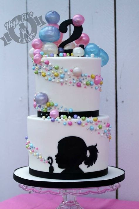 Bubble blowing silhouette cake by High Five Cakes