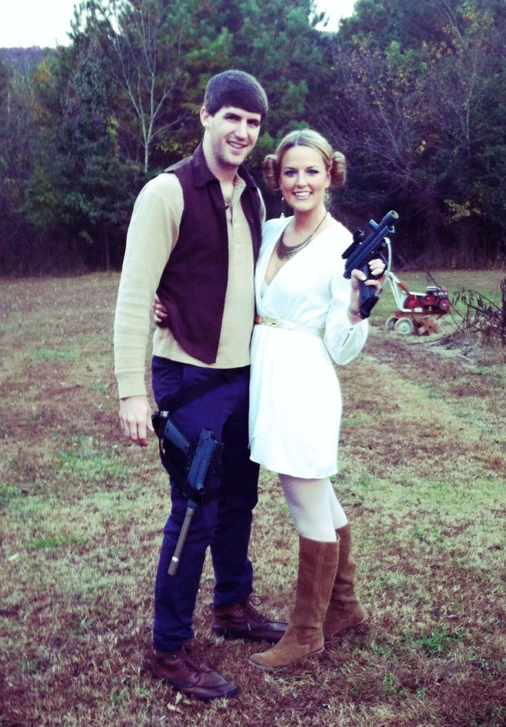easy peasy Han Solo & Princess Leia costumes...white dress, sock buns, paintball guns and a goodwill vest