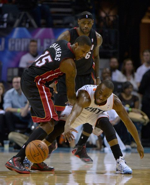 Eastern Conference, Quarterfinals, Game 3 (4/26/14) ~ Mario Chalmers (Miami Heat-15) and Kemba Walker (Charlotte Bobcats-15) go after a lose ball.  Heat won 98-85; Heat won series 4-0.