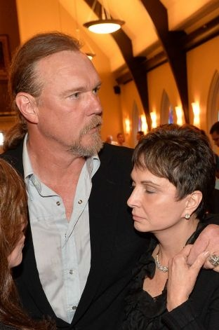 Country musician Trace Adkins and Nancy Jones attend the private visitation for George Jones on May 1, 2013