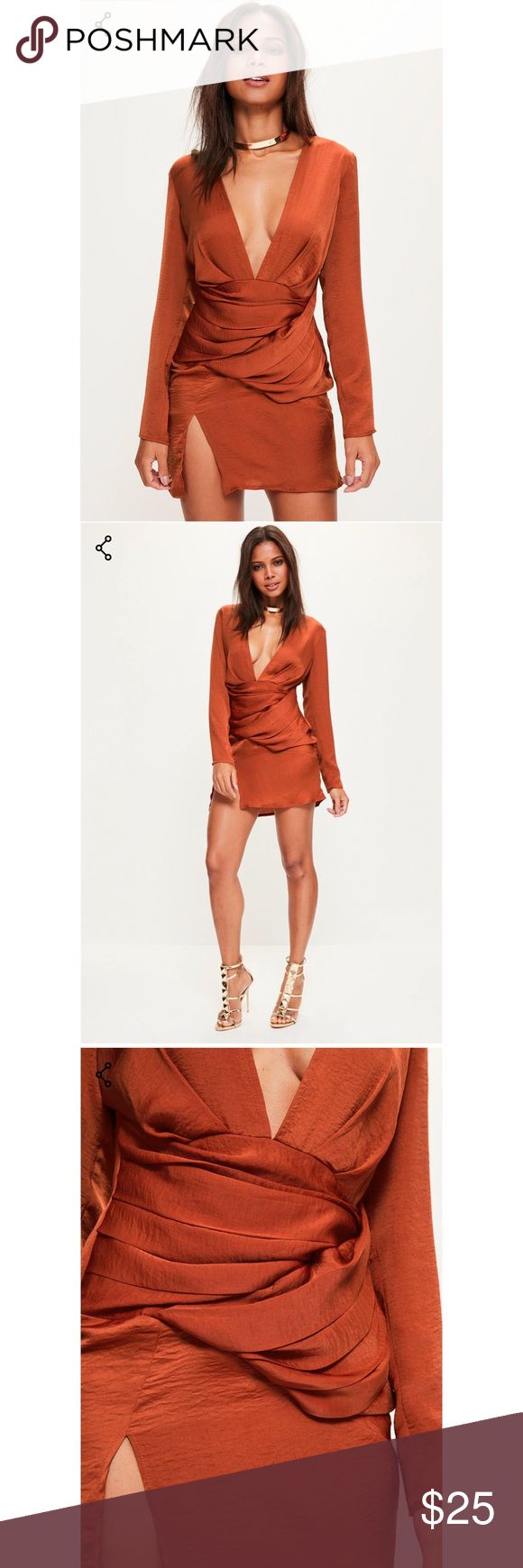 BNWT Missguided Mini Dress Size US 8 Brand new with tags Missguided size US 8 mini dress in a rust color.  Slip into this silky orange number and you're bound to turn heads this party season. this stylish long-sleeved shift dress rocks a seductive plunge neckline, while gathered detailing showing off your waist perfectly. it's a gorgeous addition to any party wear collection - pair it with sky-high heels for head-turning impact!  regular fit - concealed back zip   100% polyester. Hand wash…