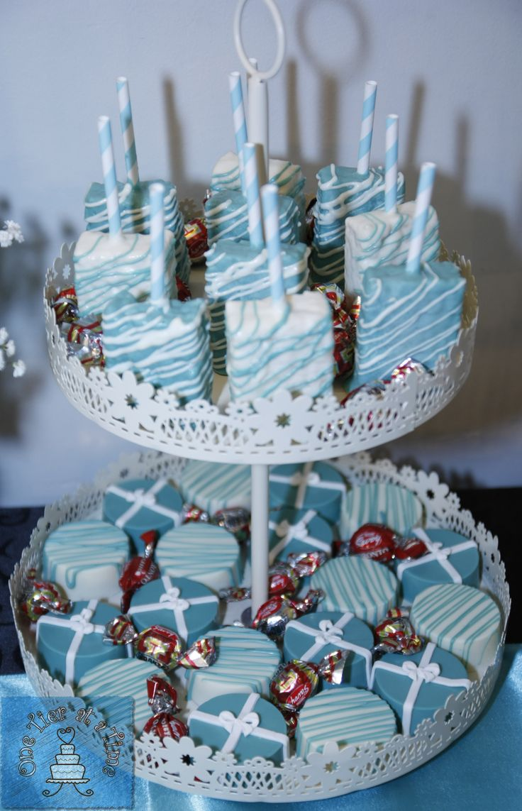 Tiffany themed dessert table created by One Tier At A Time - chocolate covered rice krispie squares and chocolate covered oreos