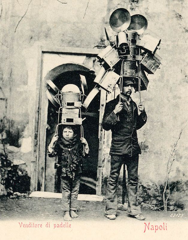 but we said, it's a rain hat! it's a living! and it's father-son time! (The Kitchenware Sellers-1903)