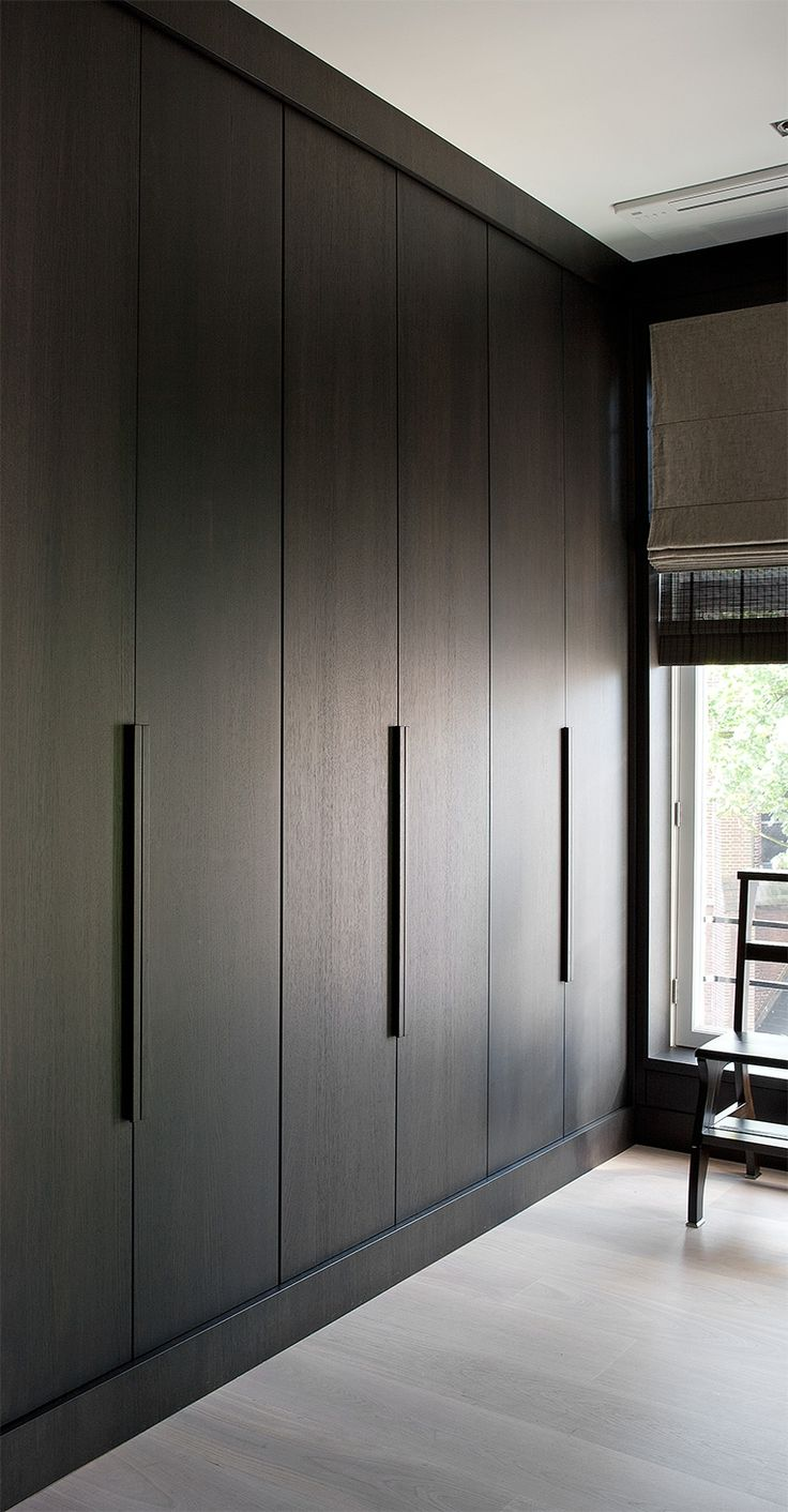 These dark wood wardrobes bring a luxe feeling to your room!