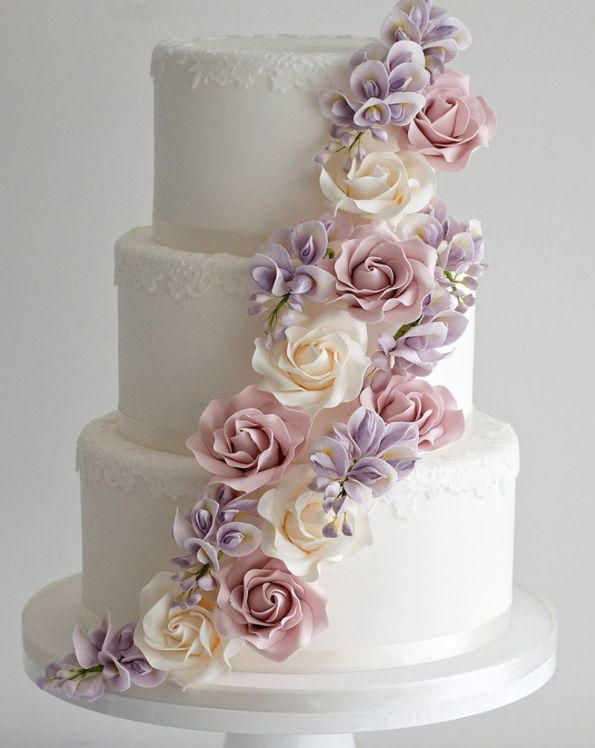 white wedding cake with cascading pastel flowers ~  we ❤ this! moncheribridals.com