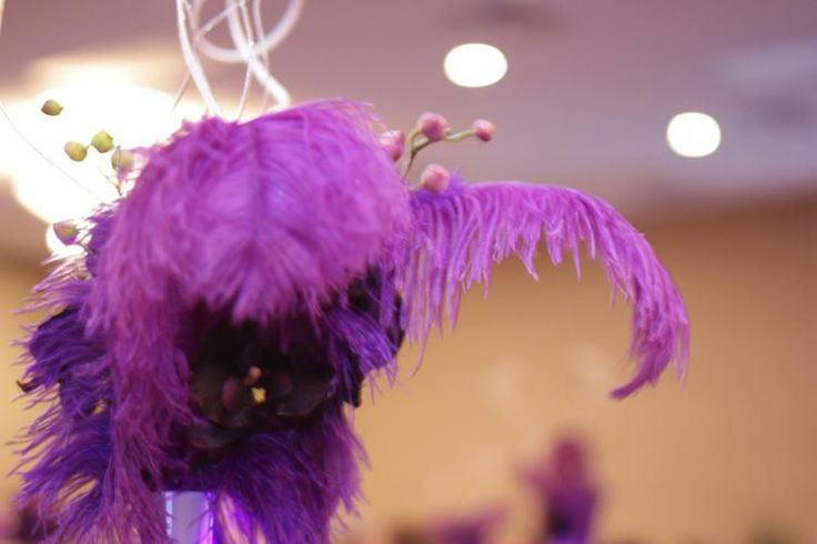 Purple Ostrich Feathers with orchids.