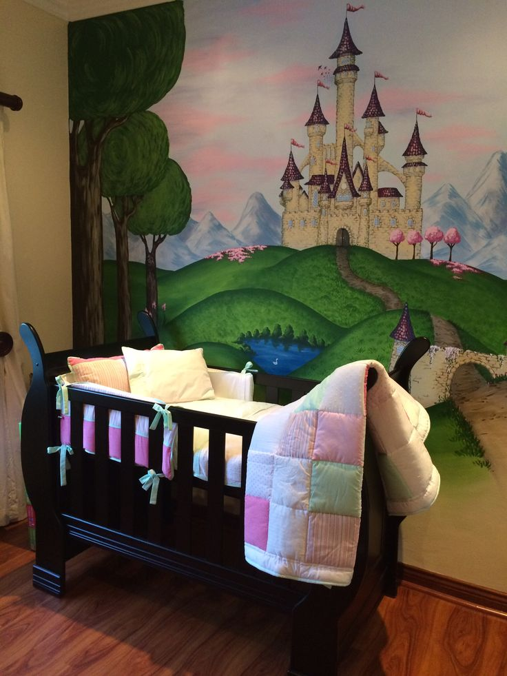 Painted a wall mural for my beautiful baby girl.. Fairy castle inspired by Cinderella's castle in Orlando disney.. Quilt and bedding by Avocadogreen, just love their stuff!!