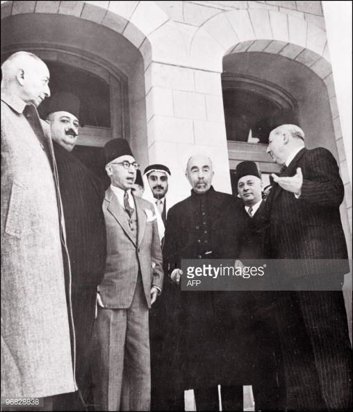 King Abdullah of Transjordan surrounded, 10 May 1948 in Amman by an unidentified man, Emir Megrid Arslan, Lebanese defense minister, Djamil Rey Mardam, Syrian Prime Minister, an other unidetified man...