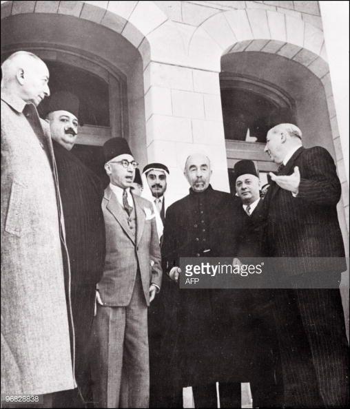 King Abdullah of Transjordan surrounded, 10 May 1948 in Amman by an unidentified man, Emir Megrid Arslan, Lebanese defense minister, Djamil Rey Mardam, Syrian Prime Minister, an other unidetified man...