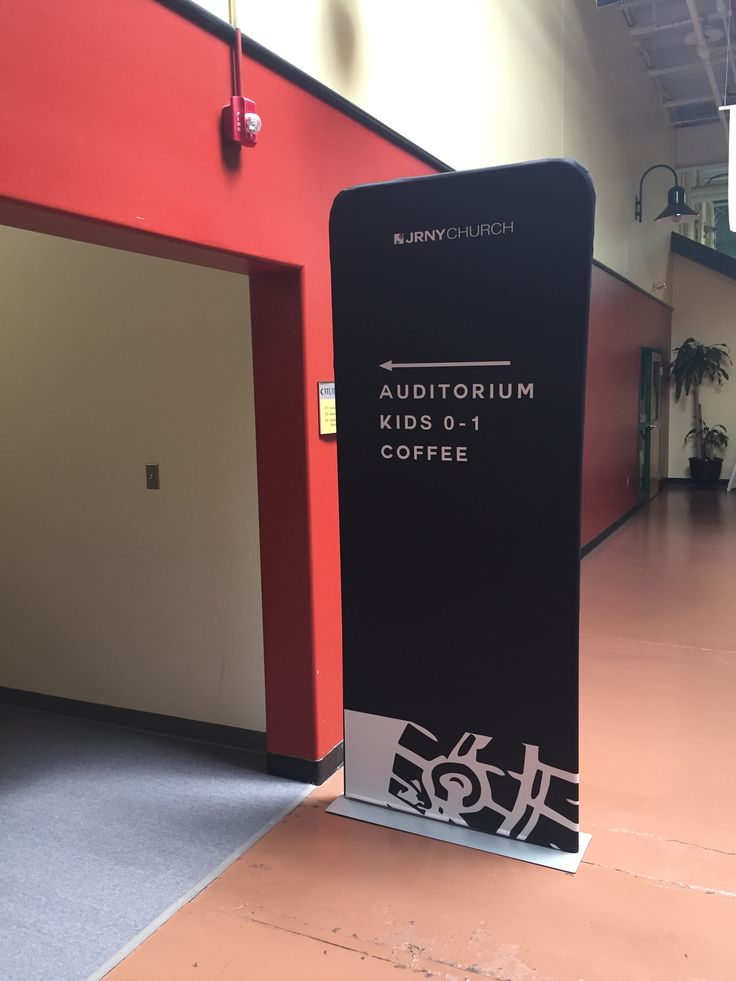 Journey Church in Pennsylvania uses a large easy-to-read two-sided banner in the lobby to designate Auditorium entrance. The FABRIC wrapper just slides over lightweight frame (like a pillowcase).