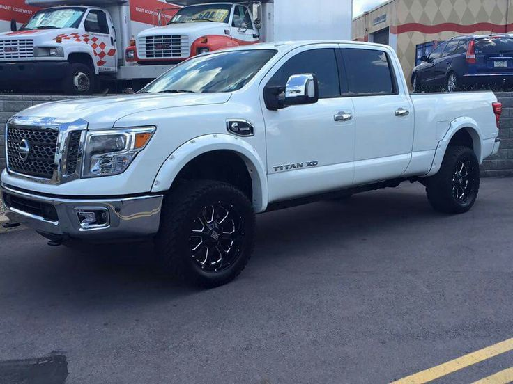 2016 Nissan Titan XD with a minor RCX lift, KMC rims and larger tires.