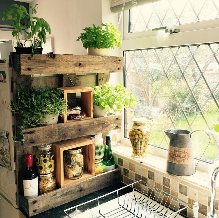 Making the most of limited naturally lit kitchen space for growing fresh herbs and sundries. Made from a reclaimed wooden pallet