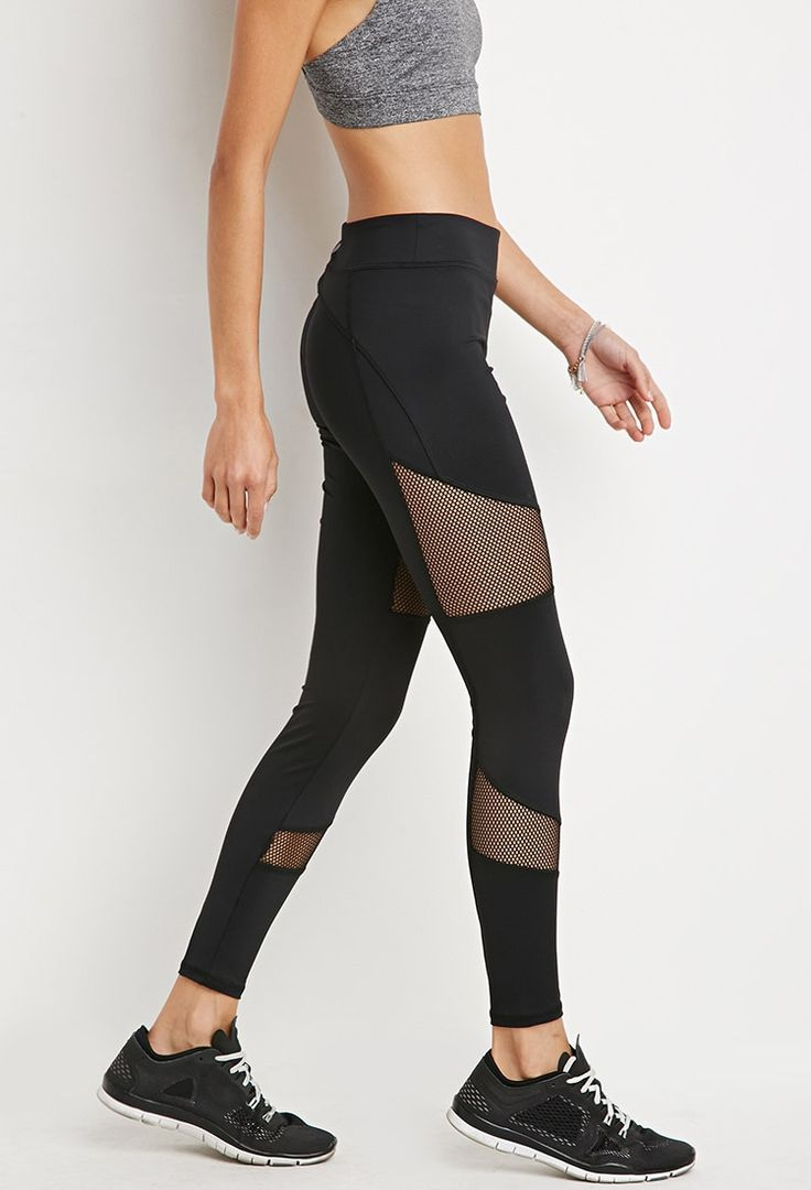 A pair of athletic leggings crafted from moisture management stretch knit with a hidden key pocket and mesh inserts on the front of each leg.