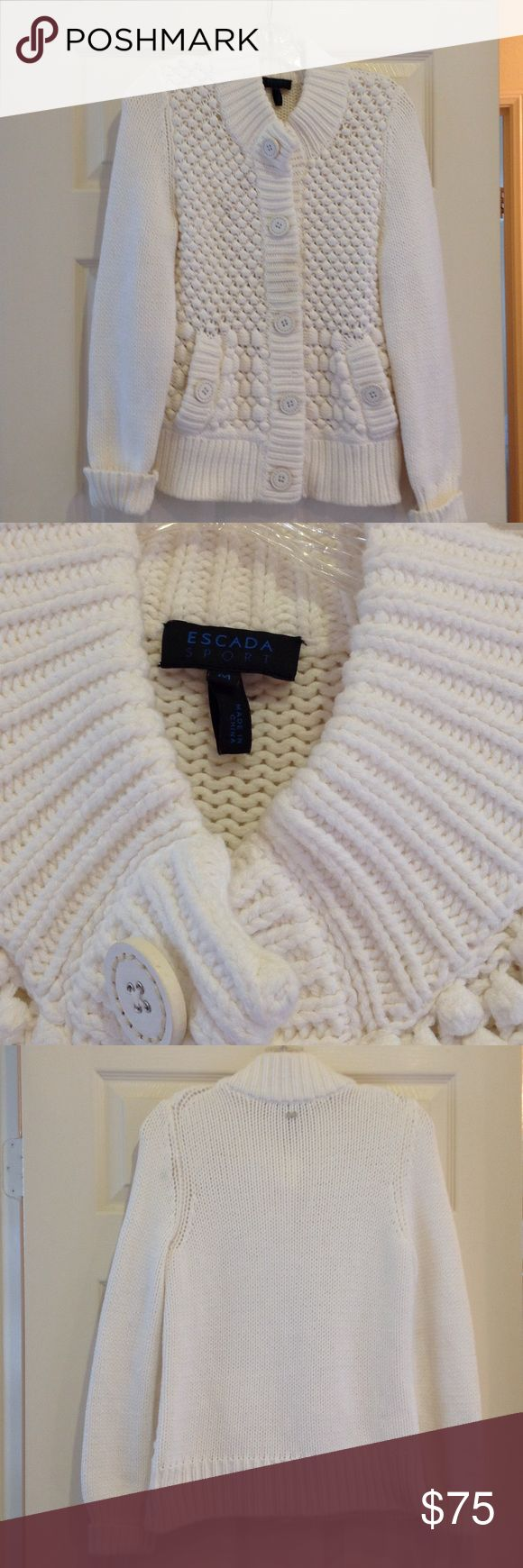 Escada Sport women's white sweater. Size M. Escada Sport, women's white chunky knit sweater. Large snap closure in front and at pockets with patent leather buttons on top. 89% cotton; 11% polyester. Size M. Escada Sport Sweaters Cardigans