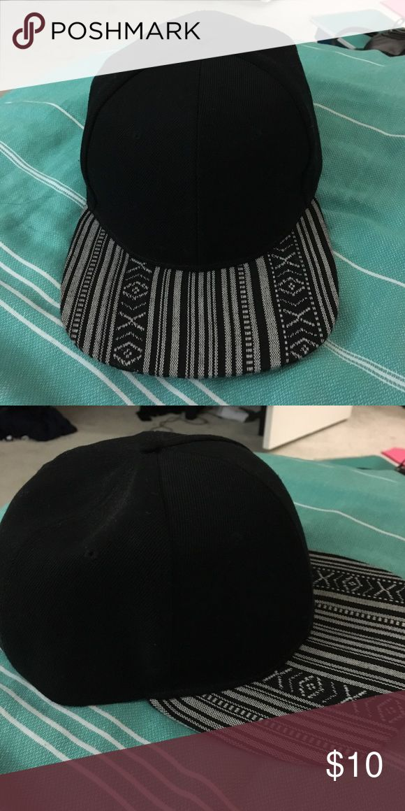 Black Snapback Hat Black with a grey tribal print bill. Lightly worn. the Hatter Company Accessories Hats