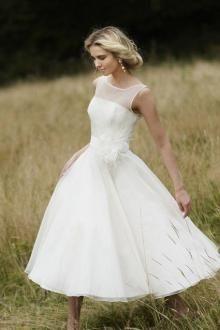 Tea length wedding dress, organza A-line skirt, sheer tulle covering the satin bodice making sleeveless illusion neck.#vintage wedding dresses#beach wedding dresses#custom wedding dresses#