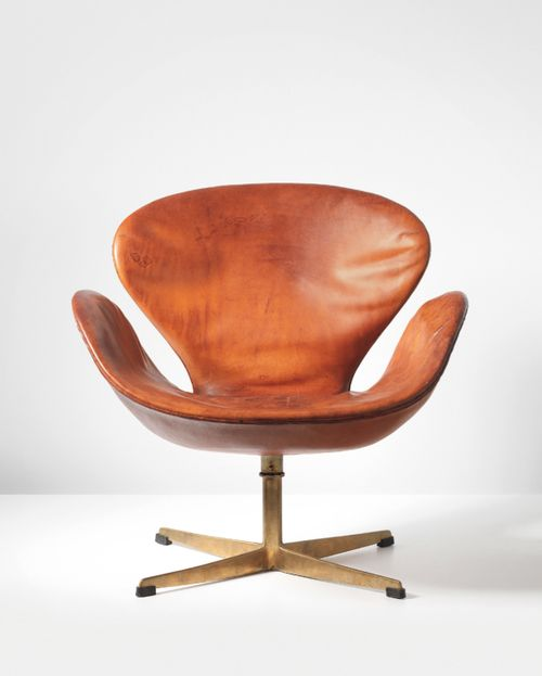 design-is-fine: Arne Jacobsen, Swan swivel chair, 1958. Leather, bronze. Manufactured by Fritz Hansen, Denmark. Via Phillips.