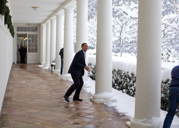 """""""Snowball in hand, the President chases Chief of Staff Rahm Emanuel on the White House colonnade. To escape, Rahm ran through the Rose Garden, which unfortunately for him, was knee-deep in snow."""""""